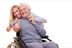 elderly woman and her caregiver showing their thumbs up